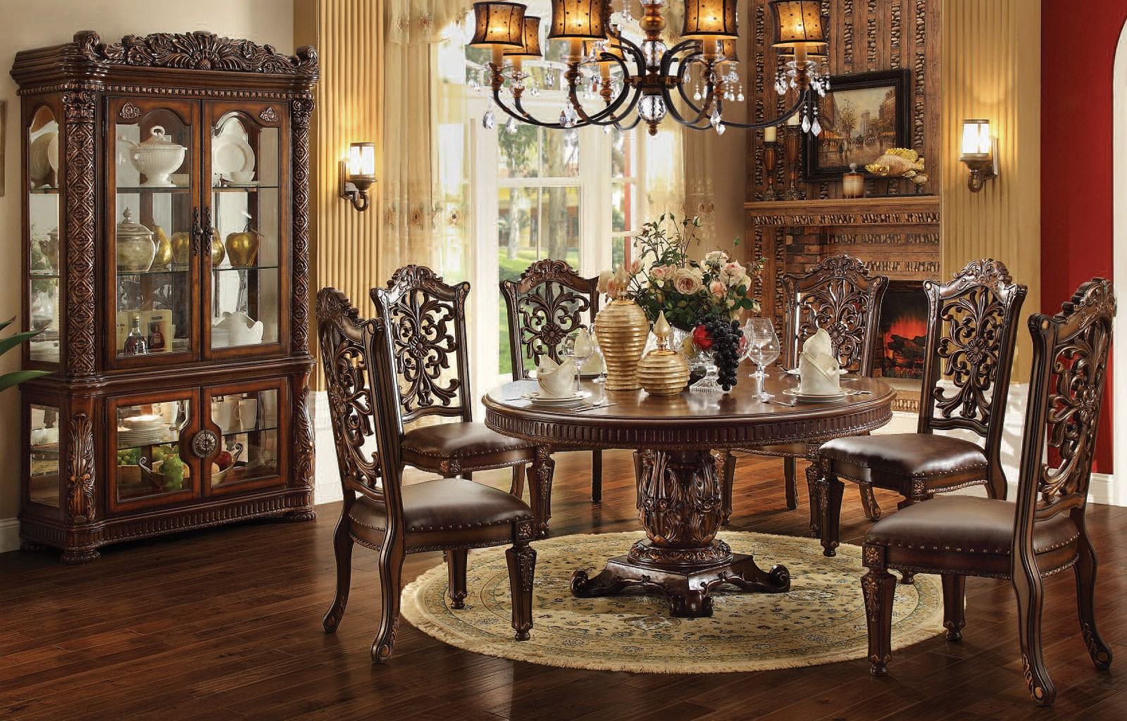 Includes: Round dining table and four upholstered chairs ...