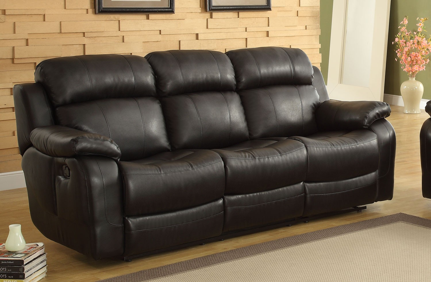 Picture of: Marille Black Double Reclining Sofa With Center Drop Down Cup Holders 1stopbedrooms