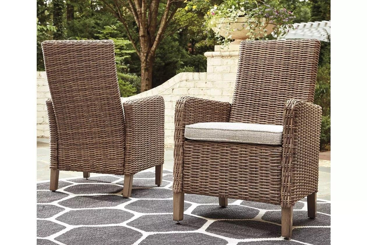 Beachcroft Beige Arm Chair with Cushion Set of 2 ... on Beachcroft Beige Outdoor Living Room Set id=63054