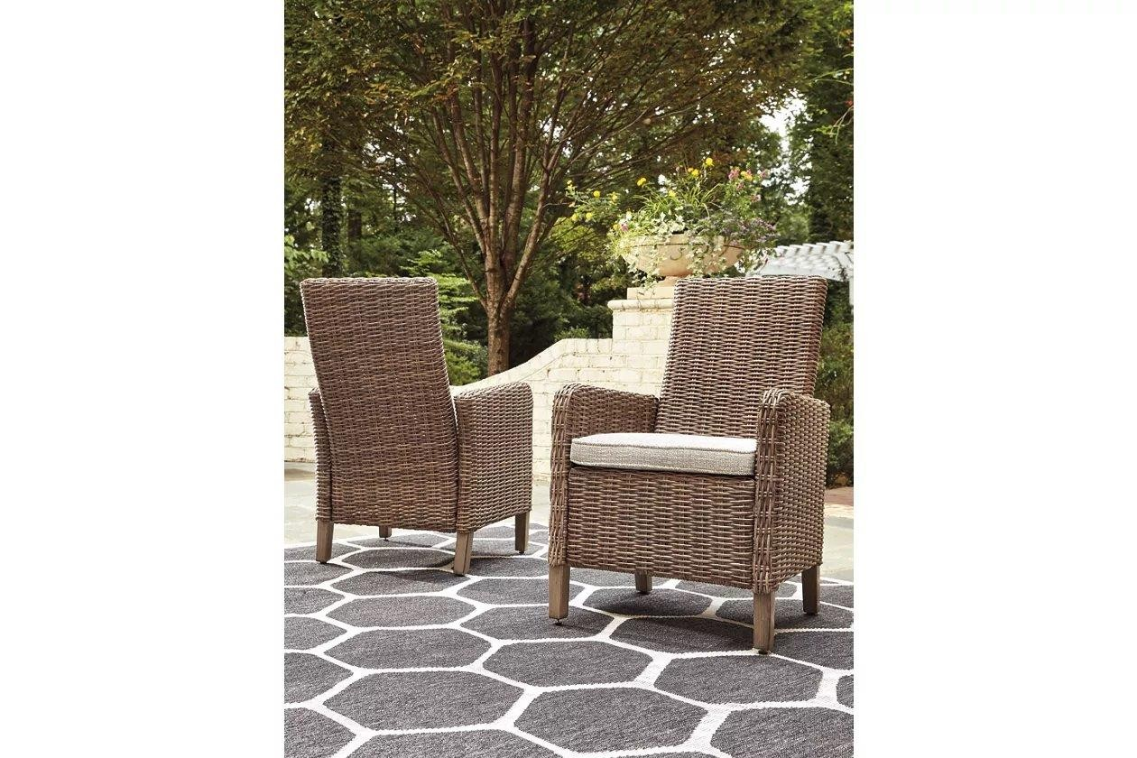 Beachcroft Beige Arm Chair with Cushion Set of 2 ... on Beachcroft Beige Outdoor Living Room Set id=31482