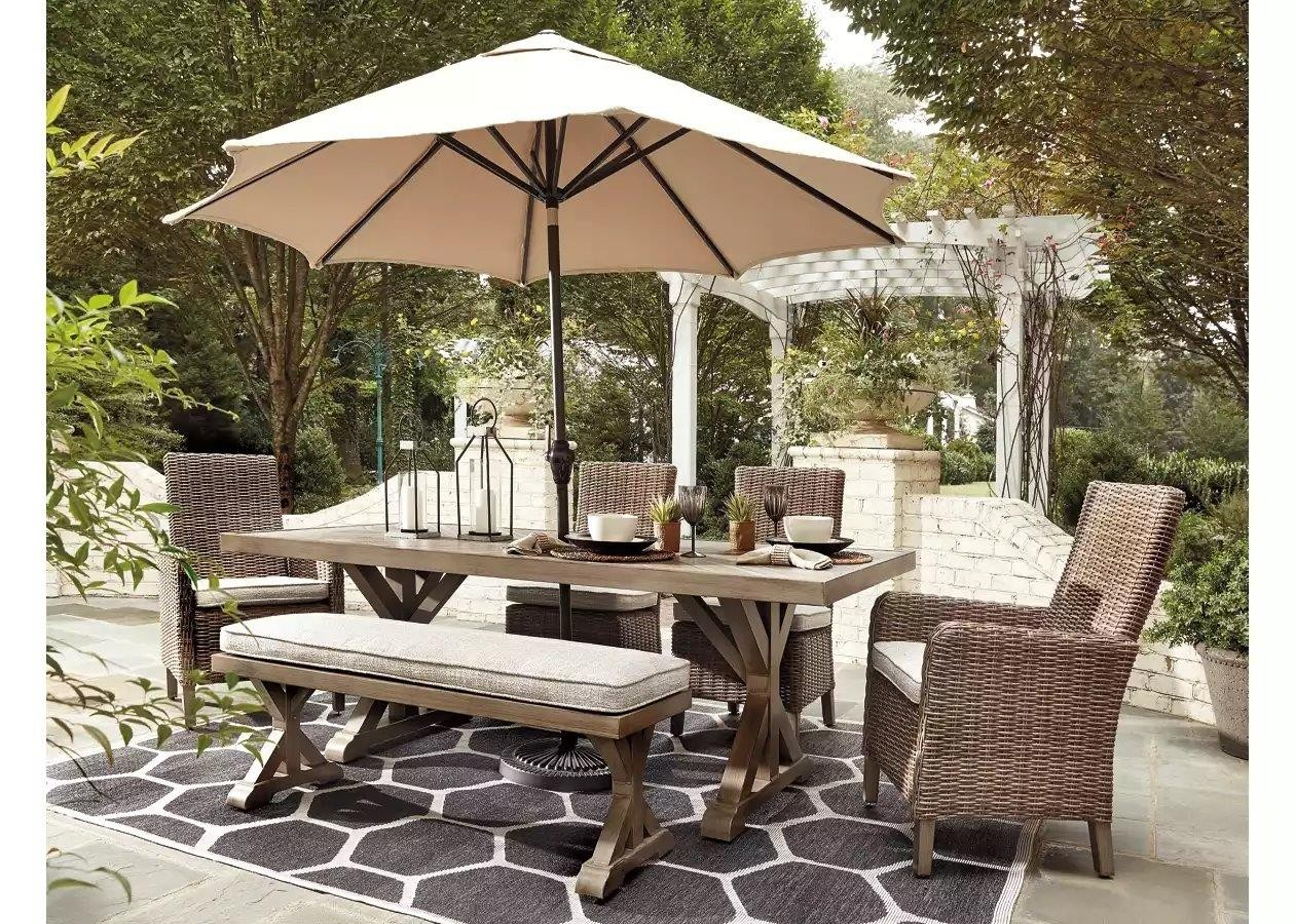 Beachcroft Beige Rectangular Dining Table - 1StopBedrooms. on Beachcroft Beige Outdoor Living Room Set id=67529
